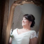 Brides reflection in mirror